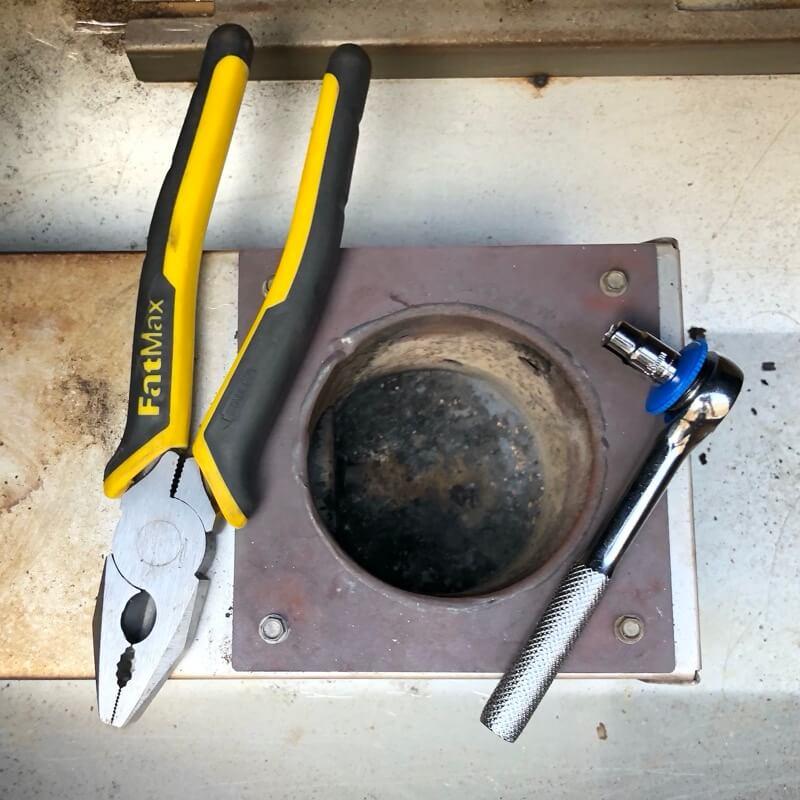 Remove fire-pot screws